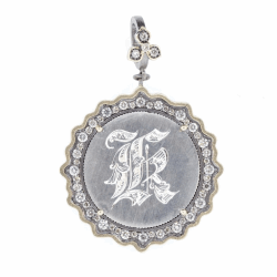 """Closeup photo of Love Token Engraved With """"K"""""""